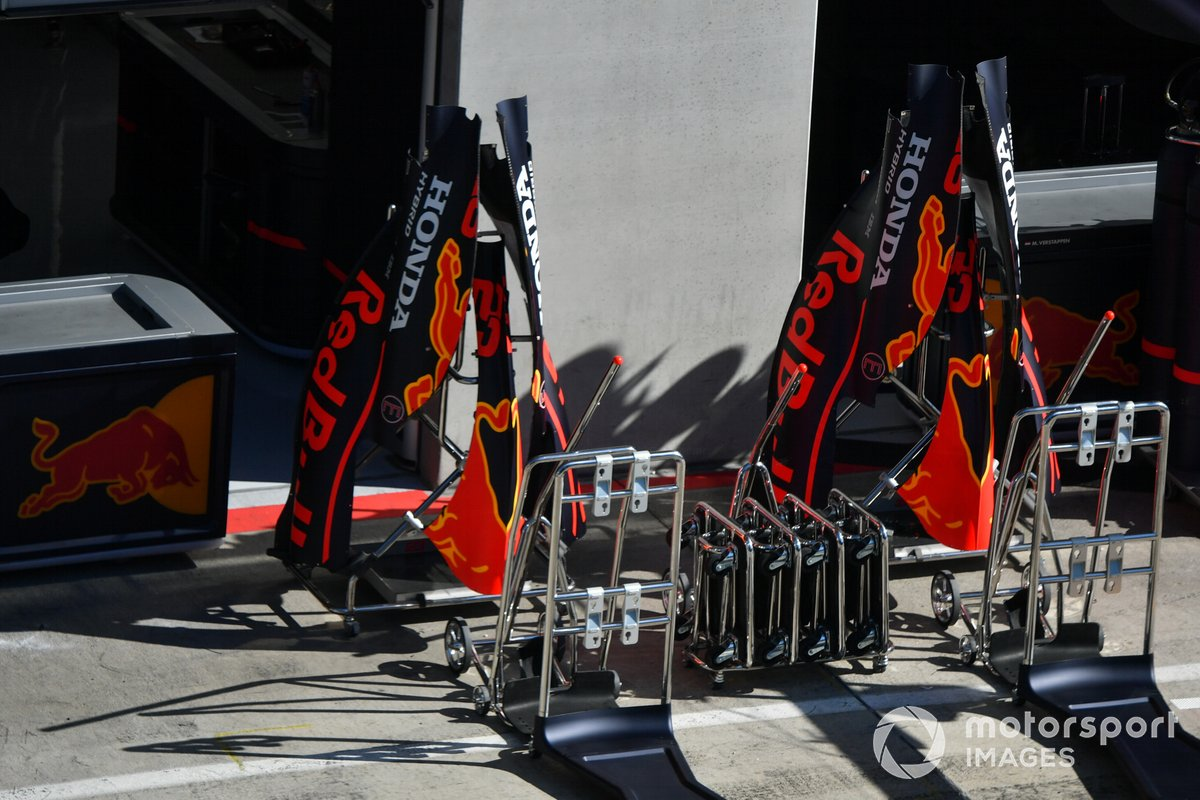 Bodywork in the pit lane outside of the Red Bull Honda garage