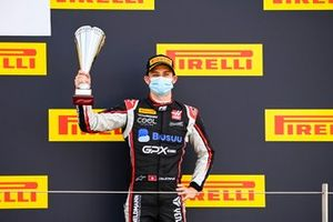 Louis Deletraz, Charouz Racing System celebrates on the podium with the trophy
