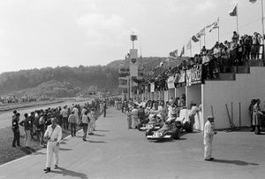 View of the pit complex with the Ferrari of Clay Regazzoni and Jacky Ickx in the foreground