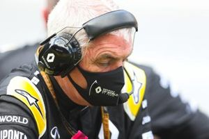 A Renault team member wears a mask on the grid