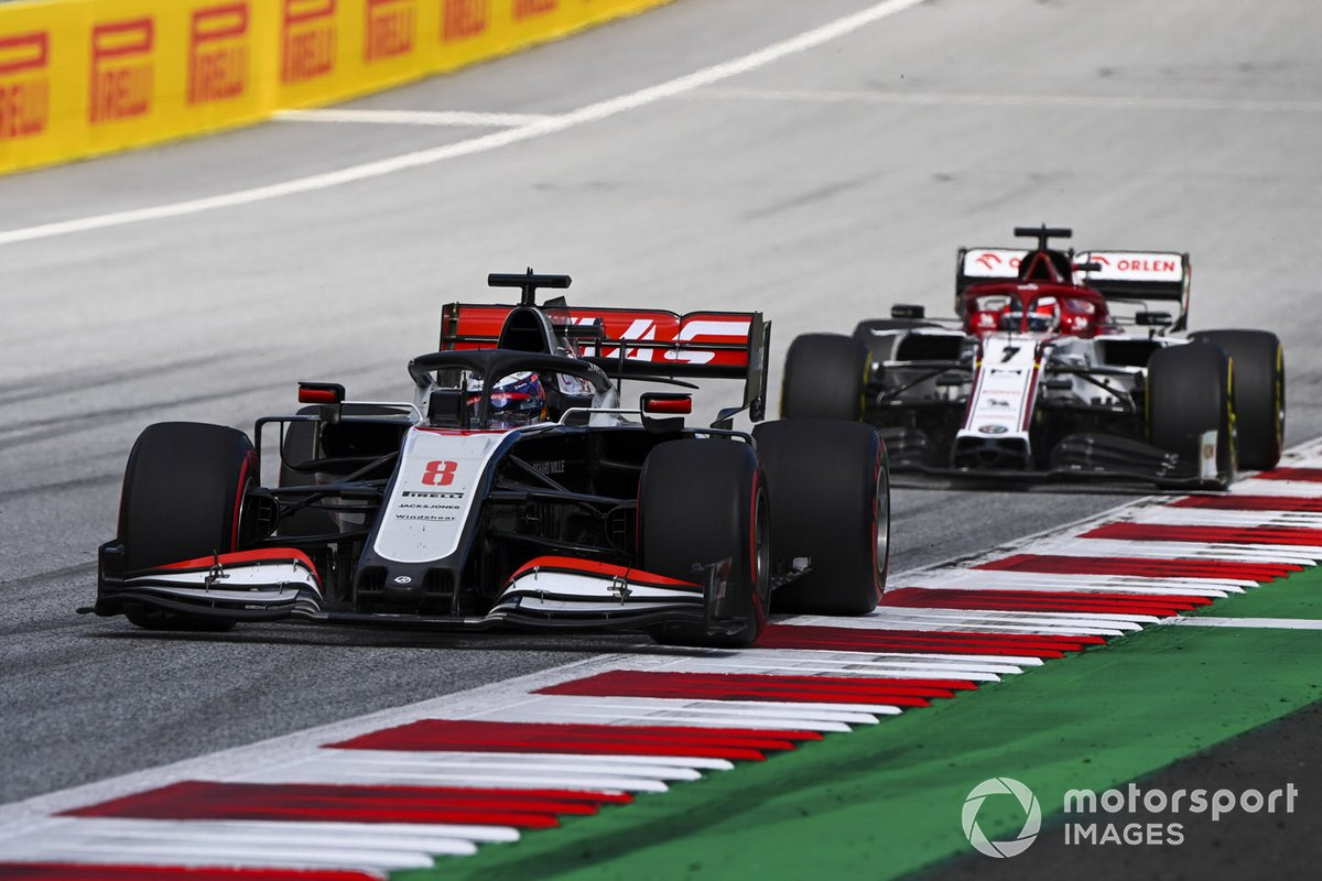 Romain Grosjean, Haas VF-20 and Kimi Raikkonen, Alfa Romeo Racing C39