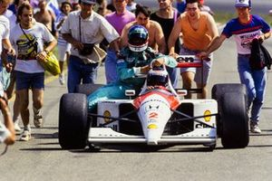 Gerhard Berger, McLaren MP4-6 Honda, gives a lift to Ivan Capelli, Leyton House Racing