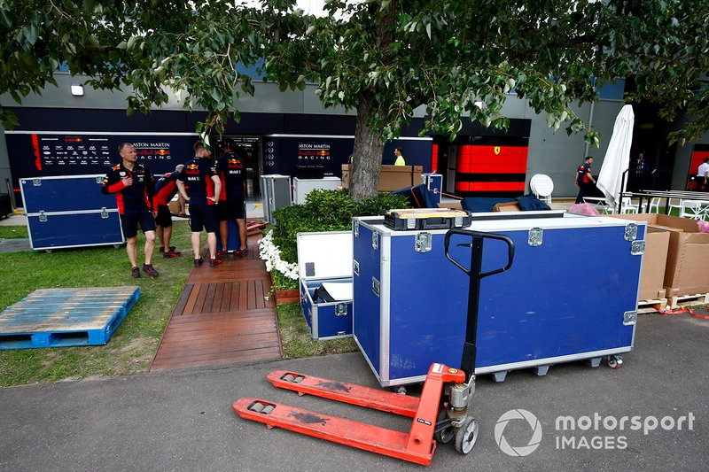Red Bull personnel pack away equipment in the paddock