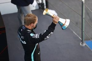 Valtteri Bottas, Mercedes-AMG Petronas F1, raises his third place trophy on the podium