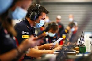 Phil Turner of Red Bull Racing works in the garage