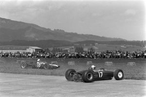 Phil Hill, Cooper T66 Climax, and Mike Hailwood, Lotus 25 BRM, spin out on to the grass