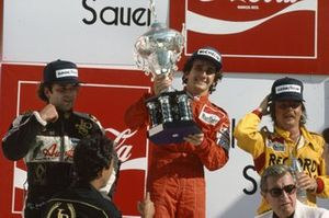 Alain Prost, 1st position,Keke Rosberg, 2nd position, and Elio de Angelis, 3rd position, FISA President Jean-Marie Balestre