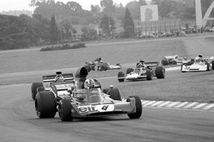 Francois Cevert, Tyrrell 00 leads the Lotus of Emerson Fittipaldi and Ronnie Peterson