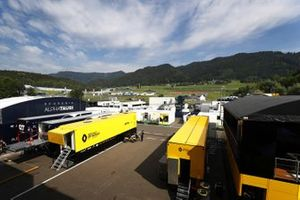 The teams prepare in the paddock