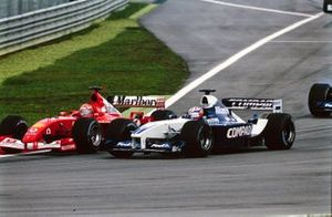 Michael Schumacher, Ferrari F2001, battles with Juan Pablo Montoya, Williams FW24 BMW