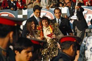 Jackie Stewart celebrates victory on the podium