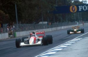 Gerhard Berger, McLaren MP4/7A Honda leads Michael Schumacher, Benetton B192 Ford