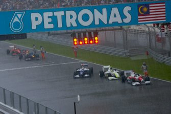 Cars stop on the main straight as the race is red flagged on lap 33 due to weather conditions