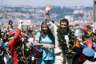 Carlos Pace, Brabham Ford, celebrates winning his home Grand Prix, second place Emerson Fittipaldi, McLaren Ford, third place Jochen Mass, McLaren Ford