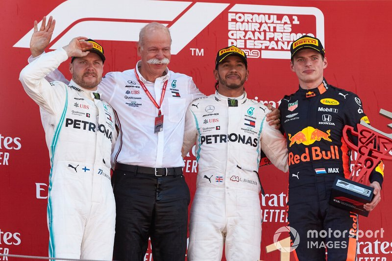 Valtteri Bottas, Mercedes AMG F1, 2nd position, Dr Dieter Zetsche, CEO, Mercedes Benz, Lewis Hamilton, Mercedes AMG F1, 1st position, and Max Verstappen, Red Bull Racing, 3rd position, on the podium