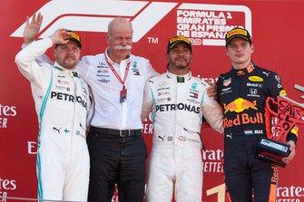 Valtteri Bottas, Mercedes AMG F1, 2nd position, Dr Dieter Zetsche, CEO, Mercedes Benz, Lewis Hamilton, Mercedes AMG F1, 1st position, and Max Verstappen, Red Bull Racing, 3rd position, on the podium