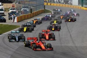 Sebastian Vettel, Ferrari SF90, leads Lewis Hamilton, Mercedes AMG F1 W10, Charles Leclerc, Ferrari SF90, Daniel Ricciardo, Renault R.S.19, Pierre Gasly, Red Bull Racing RB15, Valtteri Bottas, Mercedes AMG W10, Nico Hulkenberg, Renault R.S. 19, and the rest of the field at the start of the race
