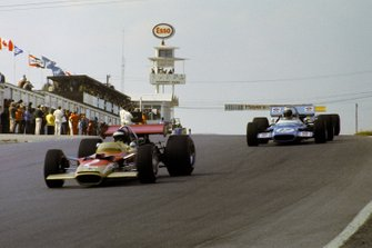 Jochen Rindt, Lotus 49B leads the race at the start of lap six, Jackie Stewart, Matra MS180, Jacky Ickx, Brabham BT26A