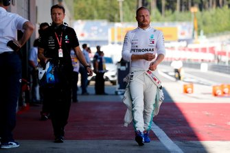 Valtteri Bottas, Mercedes AMG F1 walks down the pit lane after his crash