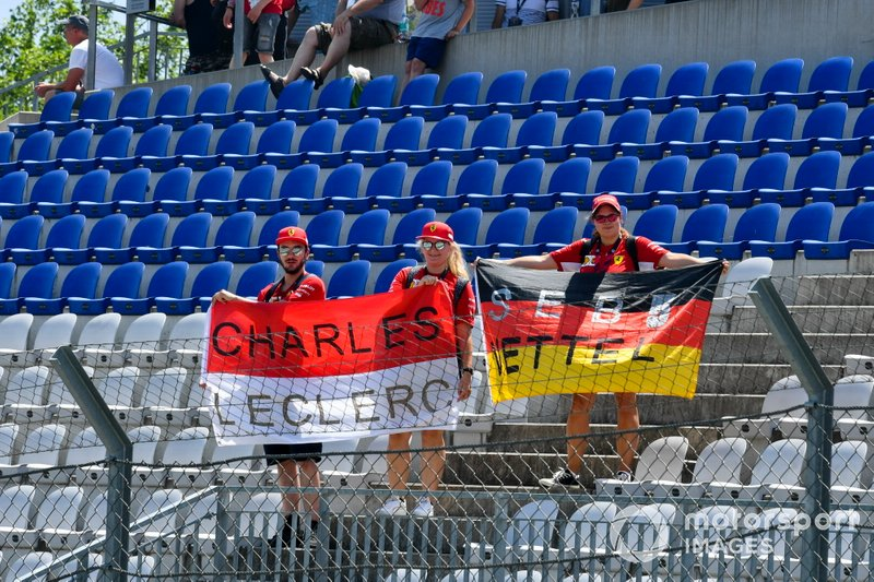Fans of Charles Leclerc, Ferrari in the grandstand with a flag