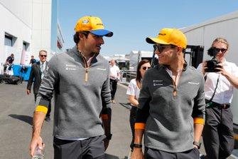 Carlos Sainz Jr., McLaren and Lando Norris, McLaren in the paddock