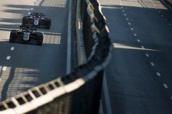 Romain Grosjean, Haas F1 Team VF-19, leads Alexander Albon, Toro Rosso STR14