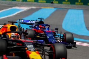 Max Verstappen, Red Bull Racing RB15, leads Daniil Kvyat, Toro Rosso STR14