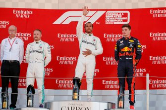 Dr Dieter Zetsche, CEO, Mercedes Benz, Valtteri Bottas, Mercedes AMG F1, Race Winner Lewis Hamilton, Mercedes AMG F1 and Max Verstappen, Red Bull Racing celebrate on the podium