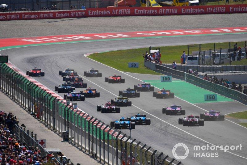 Valtteri Bottas, Mercedes AMG W10, Lewis Hamilton, Mercedes AMG F1 W10, and Sebastian Vettel, Ferrari SF90, lead the field toward the first corner at the start