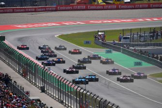 Valtteri Bottas, Mercedes AMG W10, Lewis Hamilton, Mercedes AMG F1 W10, and Sebastian Vettel, Ferrari SF90, lead the field toward the first corner at the start