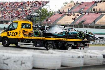 Car of Valtteri Bottas, Mercedes AMG W10 on the back of a low loader in FP3
