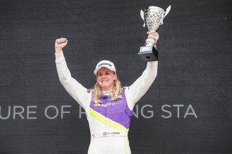 Beitske Visser celebrates on the podium after winning the race