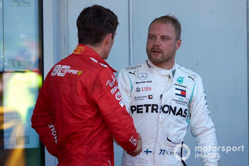 Charles Leclerc, Ferrari, seconda posizione, and Valtteri Bottas, Mercedes AMG F1, terza posizione, al Parc Ferme
