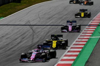 Sergio Perez, Racing Point RP19, leads Nico Hulkenberg, Renault F1 Team R.S. 19, Lance Stroll, Racing Point RP19, and Nico Hulkenberg, Renault F1 Team R.S. 19