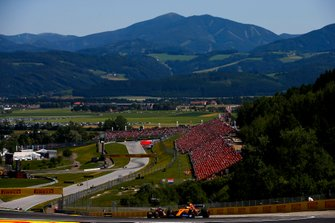 Lando Norris, McLaren MCL34, leads Pierre Gasly, Red Bull Racing RB15