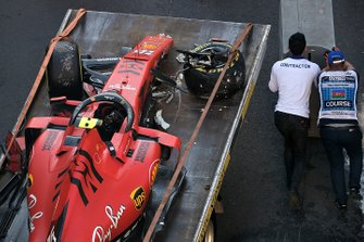 Crews remove the crashed car of Charles Leclerc, Ferrari SF90