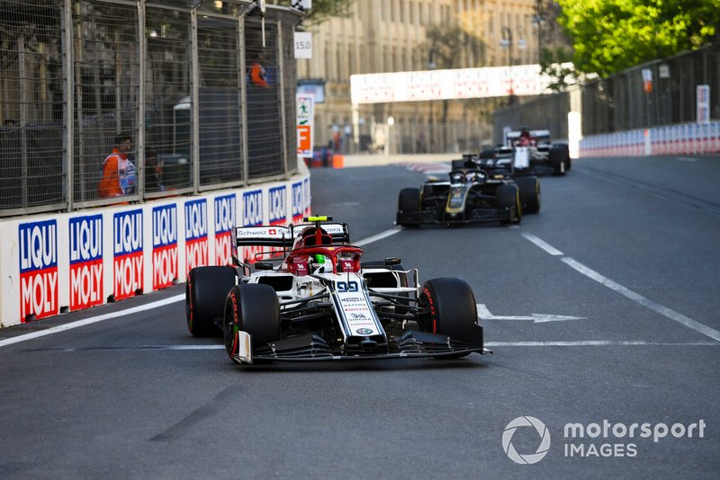 Antonio Giovinazzi, Alfa Romeo Racing C38, leads Romain Grosjean, Haas F1 Team VF-19, and Kimi Raikkonen, Alfa Romeo Racing C38