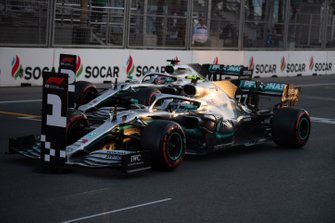 Valtteri Bottas, Mercedes AMG W10, and Lewis Hamilton, Mercedes AMG F1 W10, arrive on the grid after Qualifying