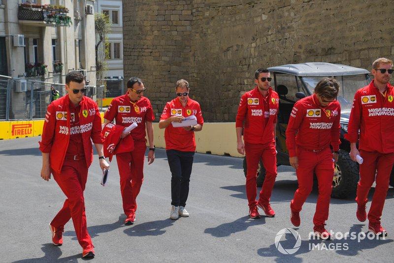 Sebastian Vettel, Ferrari walks the track with his engineers