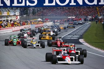 Alain Prost, McLaren MP4-5 Honda, leads teammate Ayrton Senna, at the restart