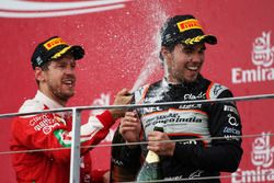 (L to R): Sebastian Vettel, Ferrari celebrates his second position on the podium with third placed S