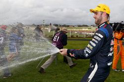 Second place Shane van Gisberge, Triple Eight Race Engineering Holden celebrates with champagne