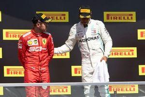 Lewis Hamilton, Mercedes AMG F1, 1st position, consoles Sebastian Vettel, Ferrari, 2nd position, on the podium