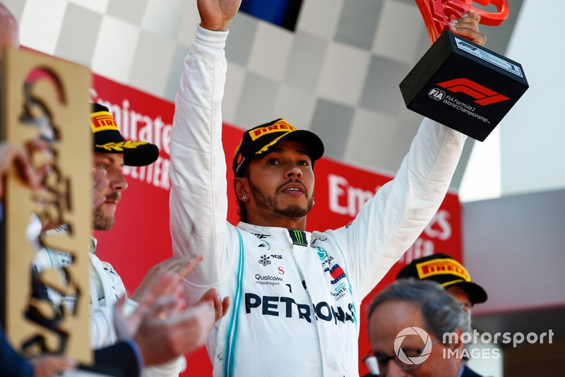 Lewis Hamilton, Mercedes AMG F1, 1st position, lifts his trophy and celebrates on the podium