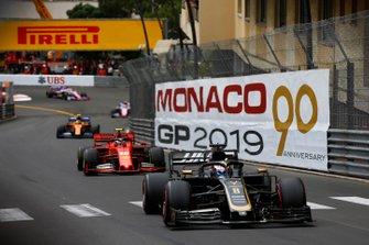 Romain Grosjean, Haas F1 Team VF-19, leads Charles Leclerc, Ferrari SF90, and Lando Norris, McLaren MCL34