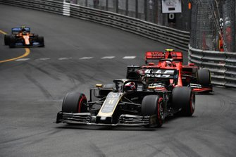 Romain Grosjean, Haas F1 Team VF-19, leads Charles Leclerc, Ferrari SF90, and Lando Norris, McLaren MCL34