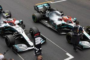 Lewis Hamilton, Mercedes AMG F1 W10, 1st position, and Valtteri Bottas, Mercedes AMG W10, 3rd position, in Parc Ferme