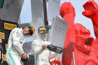 Lewis Hamilton, Mercedes AMG F1, 1st position, and Valtteri Bottas, Mercedes AMG F1, 2nd position, spray Champagne on the podium