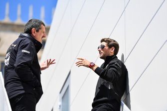 Guenther Steiner, Team Principal, Haas F1, talks with Romain Grosjean, Haas F1