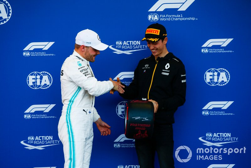 Pole man Valtteri Bottas, Mercedes AMG F1, receives his Pirelli Pole Position award from Jack Aitken, Development Driver, Renault F1